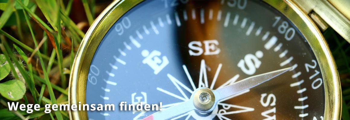 Wege gemeinsam finden. Moderatoren buchen. Bild zeigt einen Kompass